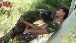 Asian Soldiers make out in the jungle