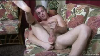 Scott plays with his dildo