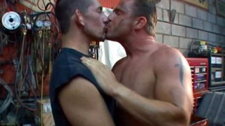 Mature muscle hunk and trucker have sex in repair shop