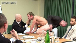 Suited board of directors use a naked man