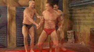 Muscle men wrestling in an orgy