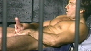 Prisoner jerks off behind bars in prison