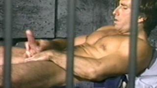 Prisoner jerks off behind bars in prison