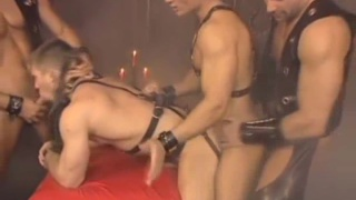 Four guys fucking in leather