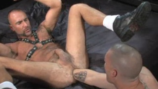 Ass stretched open with male fist fucking