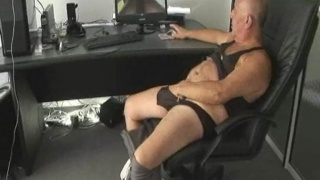Mature chubby gay Daddy masturbates while watching porn