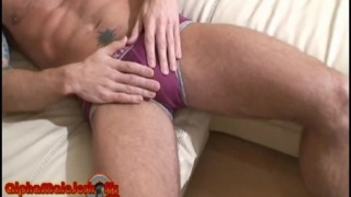 Hunk with tattoos jerking his cock