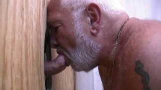 hot silverbear behind a gloryhole