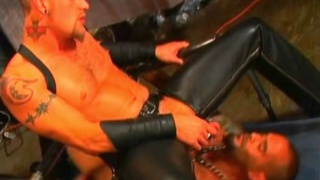 leather couple having sex