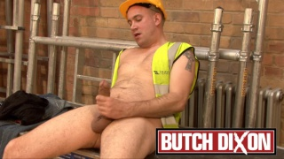 Beefy bald man jerks his 9-inch dick