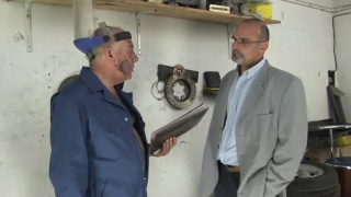 Older Man Serviced by Mechanic