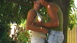 Mature Men Swapping Head Outdoors