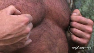 Hairy hunk stroking cock