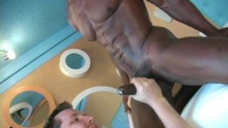 Masked black muscle dude gets a blowjob