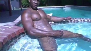 Black Muscle Hunk Jacking Poolside