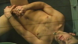 Stroking his pierced penis