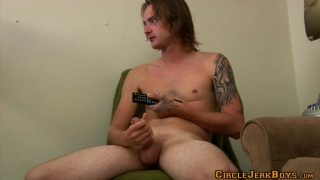 Long-Haired Inked Dude Beating Off