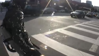 Man in Bondage Suit Rolled through Street