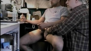 Handjobbing a Guy Watching Porn
