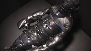 Man Bound in Full Body Leather Suit
