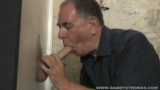 Servicing Giant Cock at Glory Hole