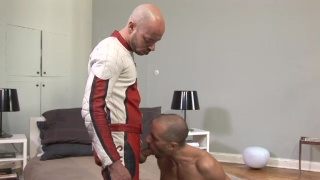 Servicing Bald Guy in Motorcycle Gear