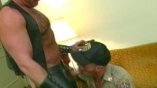 Cop sucks a leather bear's cock