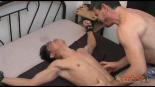Tickled asian boy squirms