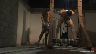 Bodybuilder in bondage