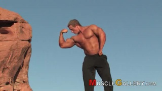 Benjamin Loehrer poses and flexes outdoors