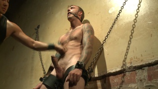 hung stud chained to a wall