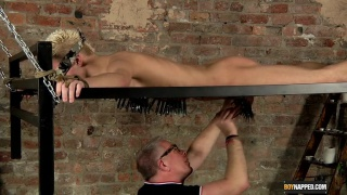 hung slave boy's painful ordeal