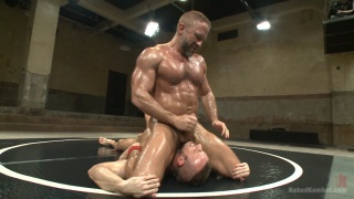 daddy wrestles stud and fucks him on mats