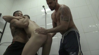 two hunks dominate guy in the shower