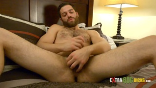 bearded furrry dude stroking his huge cock