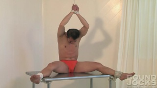 flexible bound lad unties himself