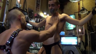 spanish men play out scene in leather shop