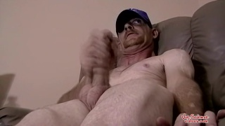 rough-looking guy jacking his hard dick