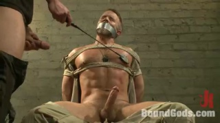 dirk caber captive in andrew justice's dungeon playroom