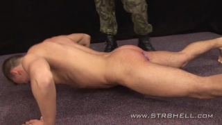 spanker in camouflage pants canes a hot butt