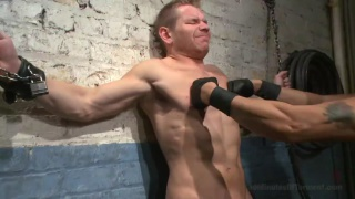 blond slave chained to the dungeon wall