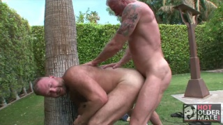 daddy fucks a cute cub outdoors in yard