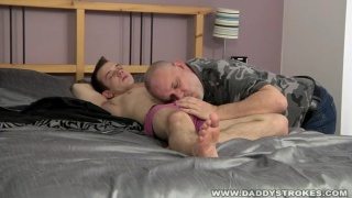 Guy Lies Back while daddy strokes his dick