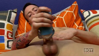 slim twink uses masturbation sleeve on his cock