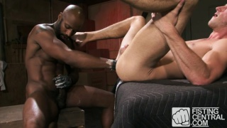 black stud handballing a hungry white hole