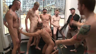 crowd of men smother sub with their feet