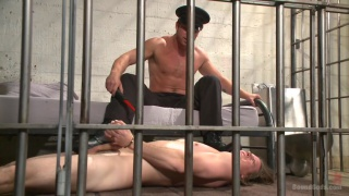 prisoner sucks the guards cock
