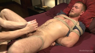 edging bound bearded guy with uncut cock