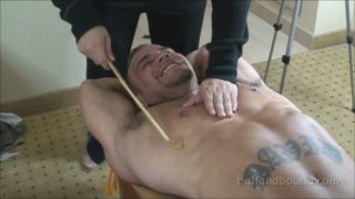 bodybuilder David Rome tied up and tickled