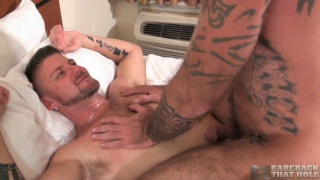 inked daddy rides a bare cock